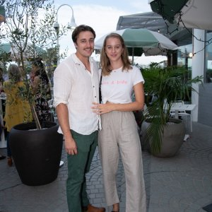 Two people smiling at event