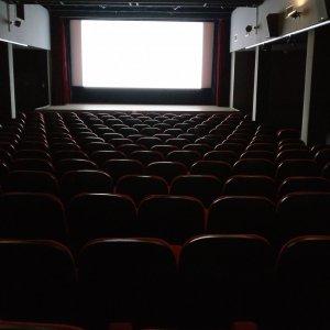 Cinema seats showing white screen