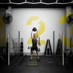 Pod1um Pod 2, Man lifting weighted ball